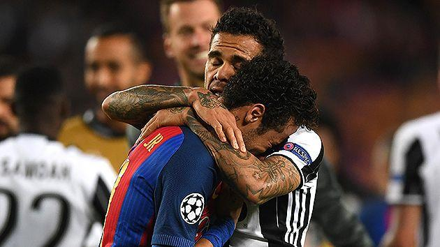 Alves consoles compatriot Neymar after the final whistle. Pic: Getty