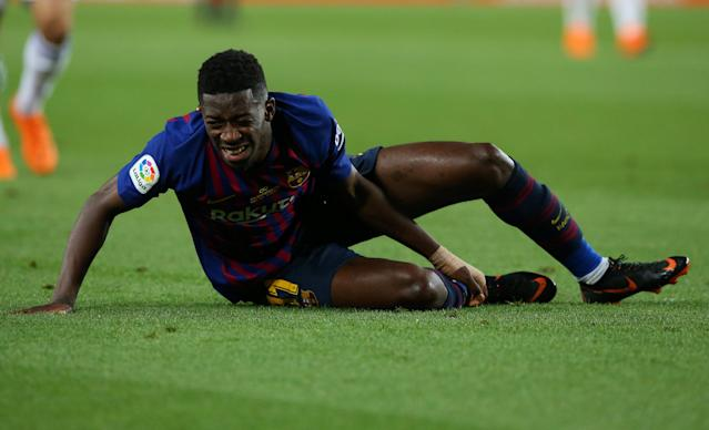 Soccer Football - La Liga Santander - FC Barcelona vs Real Sociedad - Camp Nou, Barcelona, Spain - May 20, 2018 Barcelona's Ousmane Dembele lies injured REUTERS/Albert Gea