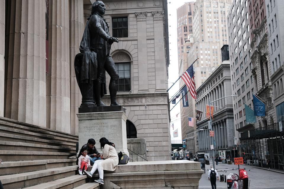 NEW YORK, NEW YORK - MAY 11: A family eats beside the New York Stock Exchange in lower Manhattan after global stocks fell as concerns mount that rising inflation will prompt central banks to tighten monetary policy on May 11, 2021 in New York City. By mid afternoon the tech-heavy Nasdaq Composite had lost 0.6% after falling 2.2% at its session low.  (Photo by Spencer Platt/Getty Images)