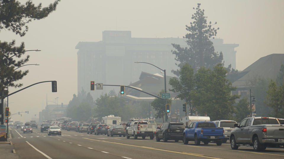 FILE - In this Aug. 30, 2021 file photo vehicles idle in bumper-to-bumper traffic in South Lake Tahoe, Calif. Wildfires burning in the U.S. this summer have upended plans for countless outdoor adventures. Campers, hikers, rafters and other outdoor enthusiasts have had to scrap or change plans or endure awful smoke. (AP Photo/Sam Metz, file)