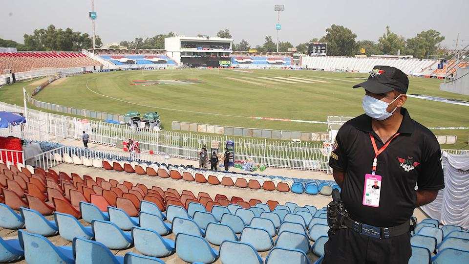 A Pakistani security forces personnel, pictured here in the cricket stadium following the cancellation.