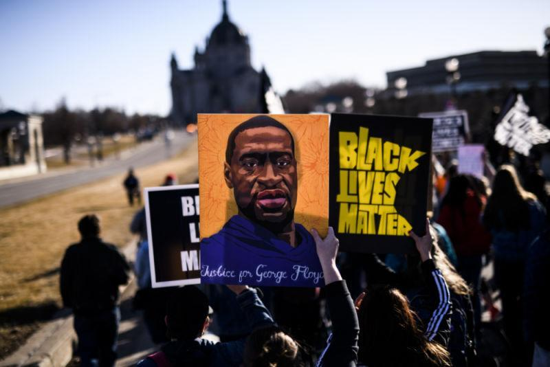 People march near the Minnesota State Capitol to honor George Floyd on March 19, 2021 in St Paul, Minnesota. This morning Judge Peter Cahill rejected motions for change of venue and continuance by the defense of former Minneapolis Police officer Derek Chauvin, who is accused of killing George Floyd last May.