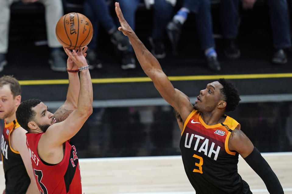 Toronto Raptors guard Fred VanVleet (23) shoots as Utah Jazz guard Trent Forrest (3) defends during the second half of an NBA basketball game Saturday, May 1, 2021, in Salt Lake City. (AP Photo/Rick Bowmer)