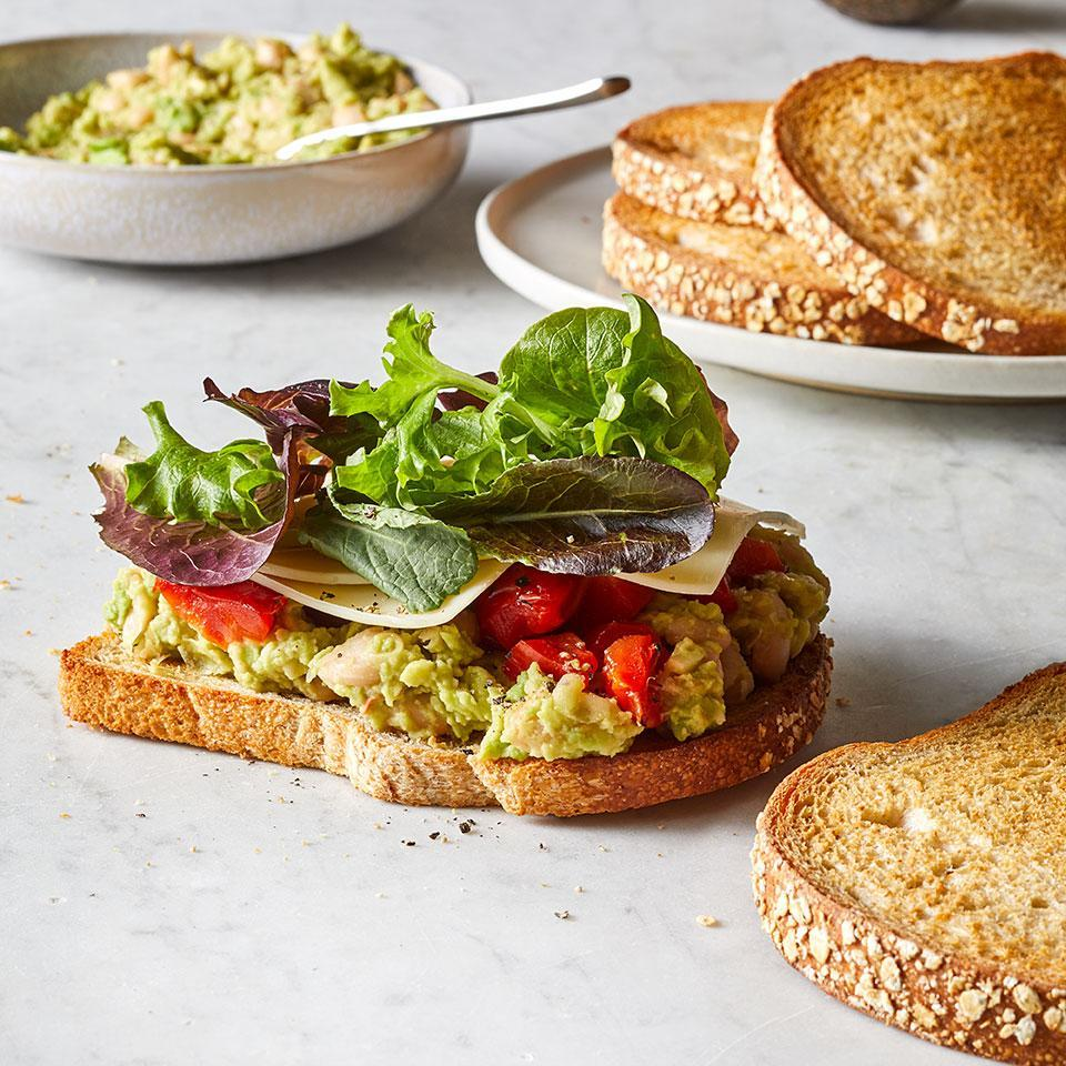 """<p>White beans mash seamlessly into a creamy protein-packed spread for a satisfying healthy sandwich that makes for an easy lunch or dinner. Mix it up by trying it with canned chickpeas or black beans. This vegetarian sandwich recipe is also a fiber superstar: avocado, beans, greens and whole-wheat bread team up to give it 15 grams of fiber, more than half of what most women should aim for in a day. <a href=""""https://www.eatingwell.com/recipe/274137/white-bean-avocado-sandwich/"""" rel=""""nofollow noopener"""" target=""""_blank"""" data-ylk=""""slk:View Recipe"""" class=""""link rapid-noclick-resp"""">View Recipe</a></p>"""