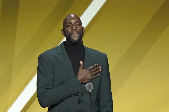 Kevin Garnett puts his hand on his heart during a speech during the 2020 Basketball Hall of Fame enshrinement ceremony, Saturday, May 15, 2021, in Uncasville, Conn. (AP Photo/Kathy Willens)