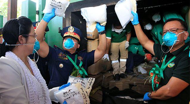 Philippine National Police (PNP) Chief Director General Ronald Dela Rosa, Philippine Drug Enforcement Agency (PDEA) Director General Isidro Lapena (R) and Public Attorney's Office (PAO) chief Persida V. Rueda-Acosta, display to members of the media plastic bags full of methamphetamine hydrochloride on July 14. Photo: Reuters/Romeo Ranoco