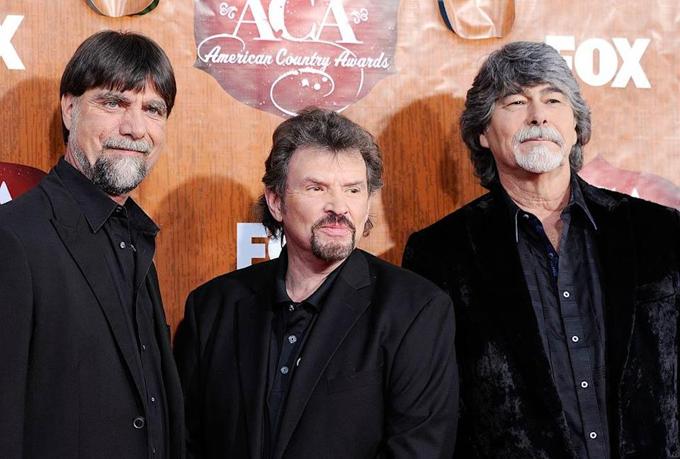 Teddy Gentry (left), Jeff Cook (middle), and Randy Owen (right) of the band Alabama arrive at the American Country Awards held at the MGM Grand Garden Arena in Las Vegas. (12/5/2011)