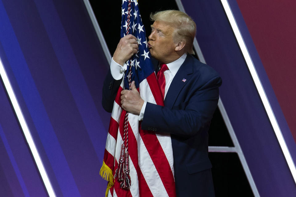 President Donald Trump kisses the American flag after speaking at Conservative Political Action Conference, CPAC 2020, at the National Harbor in Oxon Hill, Md., Saturday, Feb. 29, 2020. (AP Photo/Jose Luis Magana)