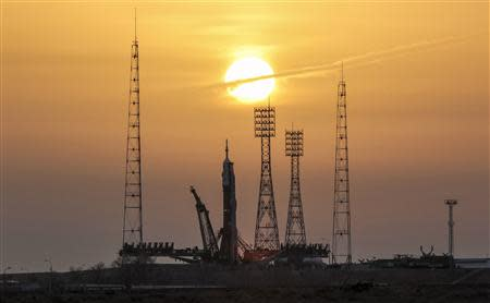 The Soyuz TMA-20 spacecraft is set up on its launch pad at Baikonur cosmodrome December 13, 2010. REUTERS/Shamil Zhumatov