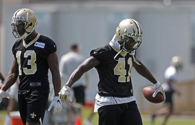 New Orleans Saints running back Alvin Kamara (41) and receiver Michael Thomas (13) are on opposite sides of overrated and underrated fantasy draft picks. (AP Photo/Gerald Herbert)
