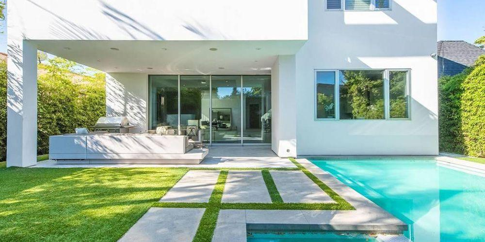 <p>The lush backyard includes a pool and BBQ. </p>