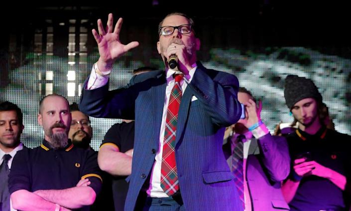 Gavin McInnes speaks on stage with Proud Boys in New York City on 20 January 2018.