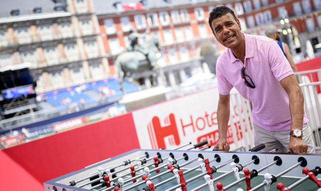 Chris Kamara challenges fans to a game of foosball at the Hotels.com Champions Retreat in Plaza Mayor ahead of the UEFA Champions League final (Photo by Samuel de Roman/Getty Images for Hotels.com)