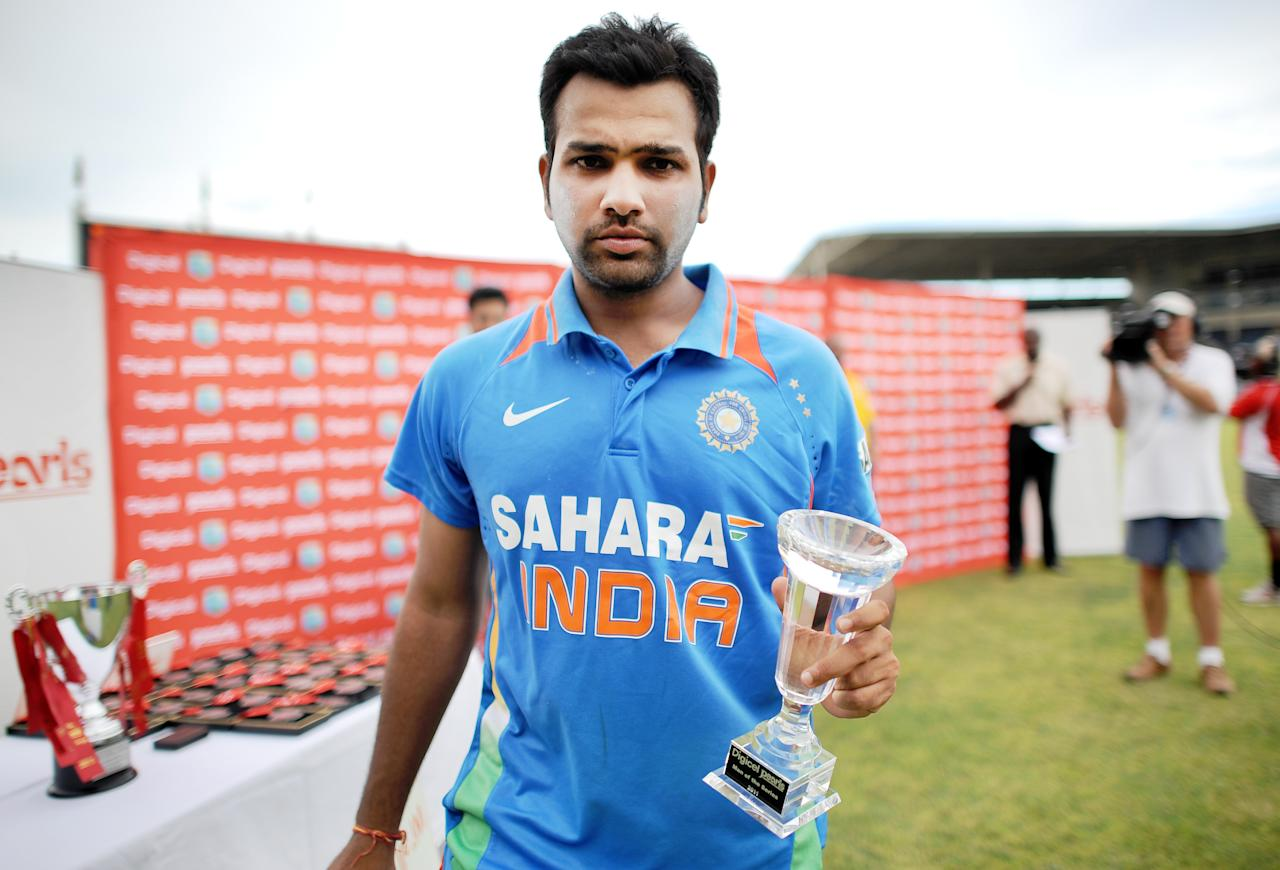 Indian cricketer and Man of the Series Rohit Sharma poses with his trophy at the end of the fifth One Day International match between West Indies and India at the Sabina Park Stadium in Kingston on June 16, 2011. India won the series by 3-2. AFP Photo/Jewel Samad (Photo credit should read JEWEL SAMAD/AFP/Getty Images)