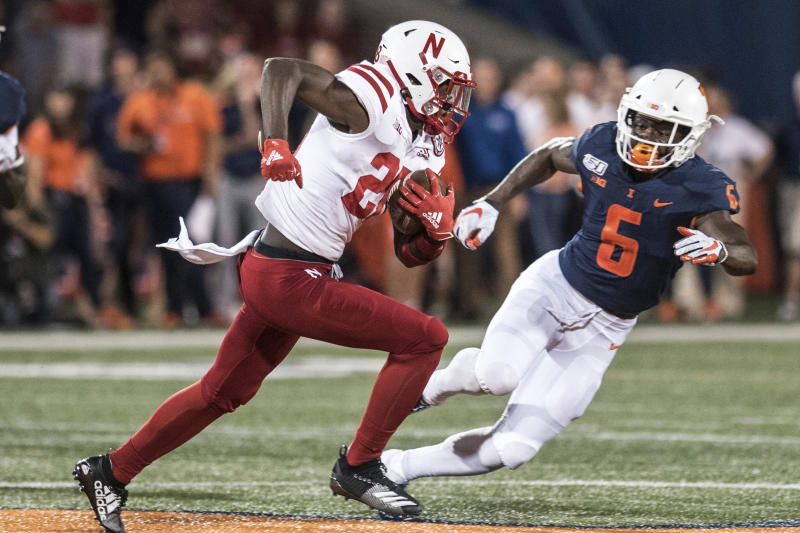 Nebraska's Maurice Washington (28) runs with the ball as Illinois' Tony Adams (6) defends in the first half of an NCAA college football game, Saturday, Sept. 21, 2019, in Champaign, Ill. (AP Photo/Holly Hart)