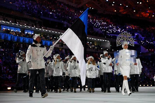 SOCHI, RUSSIA - FEBRUARY 07: Biathlete Indrek Tobreluts of the Estonia Olympic team carries his country's flag during the Opening Ceremony of the Sochi 2014 Winter Olympics at Fisht Olympic Stadium on February 7, 2014 in Sochi, Russia. (Photo by Paul Gilham/Getty Images)