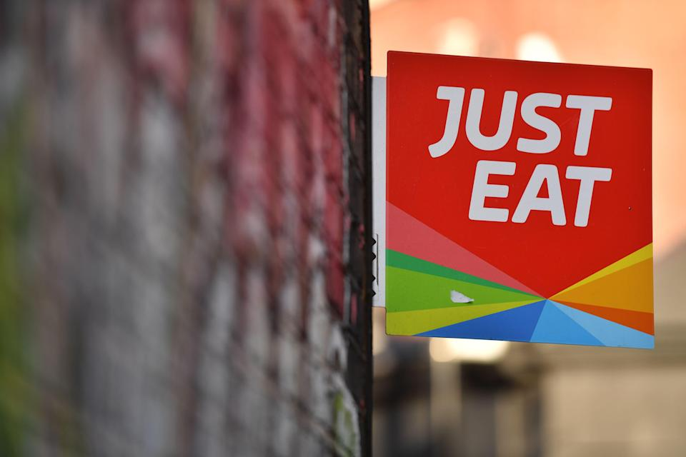 A sign for Just Eat, a food delivery service can be seen above a restaurant in London on December 18, 2017. Photo: BEN STANSALL/AFP/Getty Images