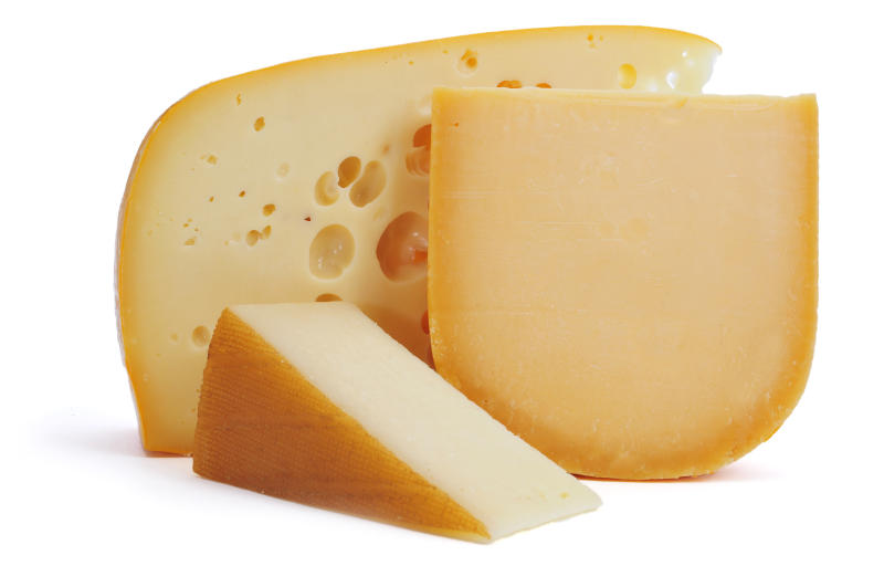 closeup of some pieces of cheese, such as Gouda or Leerdammer