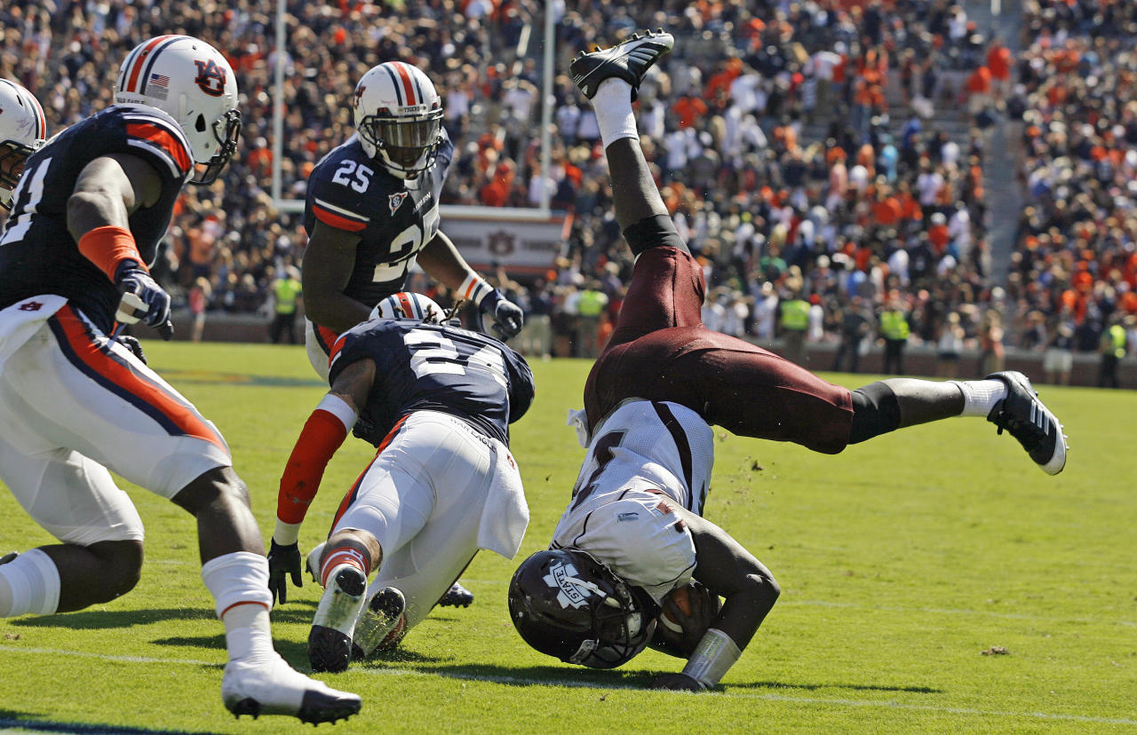 Mississippi State quarterback Chris Relf (14) is upended short of the goal line on the final play of the game as Auburn defensive back Ryan Smith (24) defends during an NCAA college football game in Auburn, Ala., Sept. 10, 2011. Auburn won 41-34. (AP Photo/Mike Kittrell, Mobile Press Register) MAGS OUT, NO SALES