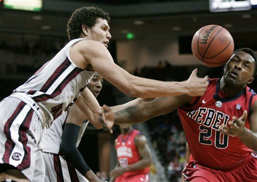 Mississippi Nick Williams (20) vies for the rebound with South Carolina's Michael Carrerra (24) during the first half of an NCAA college basketball game Wednesday, Feb. 20, 2013, in Columbia, S.C. (AP Photo/Mary Ann Chastain)