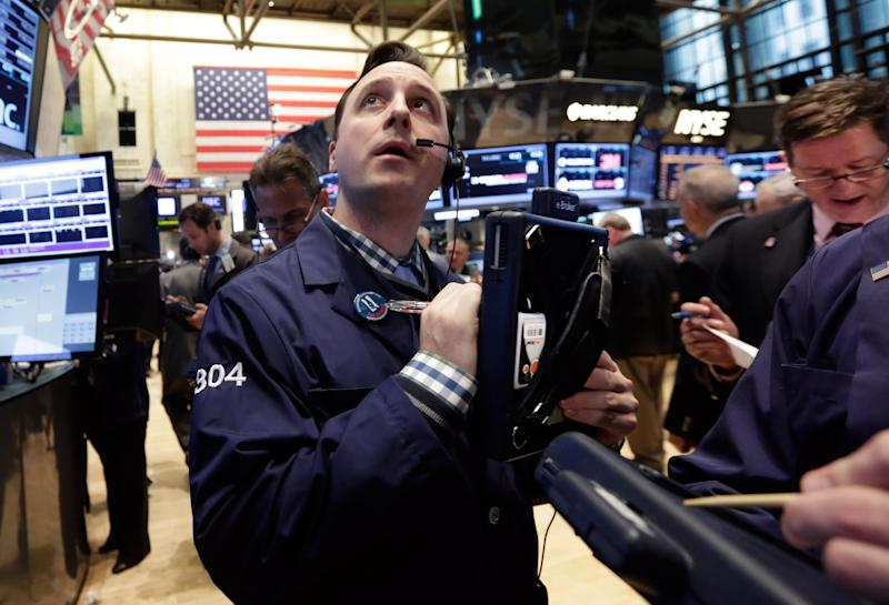 Traders work on the floor of the New York Stock Exchange Wednesday, April 23, 2014. A six-day rally on the stock market is petering out as some U.S. companies report earnings that disappoint investors. (AP Photo/Richard Drew)