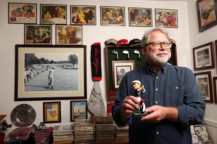 Mark Baron poses with some of his Ben Hogan memorabilia at his home in El Cajon.