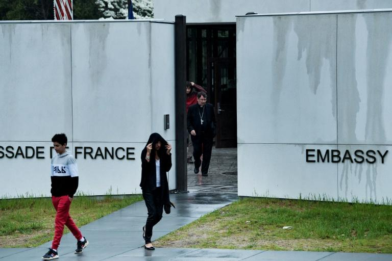 French citizens leave after voting in the country's presidential election at the Embassy of France on April 22, 2017 in Washington, DC