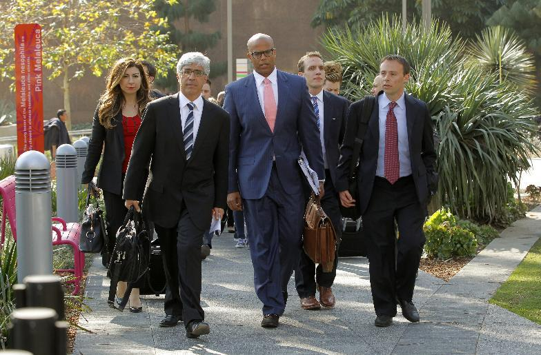 Attorneys Theodore Boutrous, second form left, and Marcellus McRae, third from left, representing nine California public school students who are suing the state to abolish its laws on teacher tenure, seniority, and other protections, walk to a news conference outside the Los Angeles Superior Court Monday, Jan. 27, 2014 in Los Angeles. Their case Vergara v. California is the latest battle in a growing nationwide challenge to union-backed protections for teachers. (AP Photo/Nick Ut)