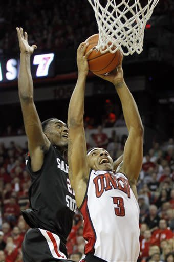 San Diego State's Jamaal Franklin attempts to block the shot of UNLV's Anthony Marshall during the second half of an NCAA college basketball game on Saturday, Feb. 11, 2012, in Las Vegas. (AP Photo/Isaac Brekken)