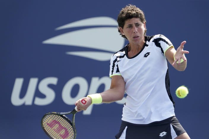 Carla Suarez Navarro, of Spain, returns a shot to Danielle Collins, of the United States, during the first round of the US Open tennis championships, Monday, Aug. 30, 2021, in New York. (AP Photo/John Minchillo)
