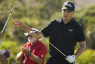 Jordan Spieth reaches for a club on the 11th hole during the first round of the PGA Championship golf tournament on the Ocean Course Thursday, May 20, 2021, in Kiawah Island, S.C. (AP Photo/Matt York)