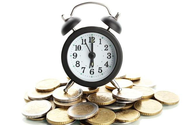 alarm clock with coins isolated ...
