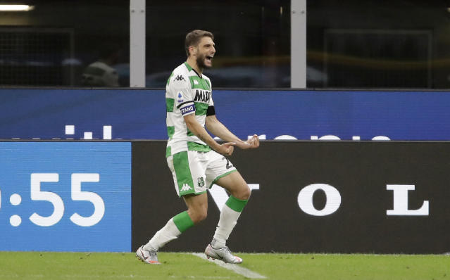 Sassuolo's Domenico Berardi celebrates after scoring his side's second goal during the Serie A soccer match between Inter Milan and Sassuolo at the San Siro Stadium, in Milan, Italy, Wednesday, June 24, 2020. (AP Photo/Luca Bruno)