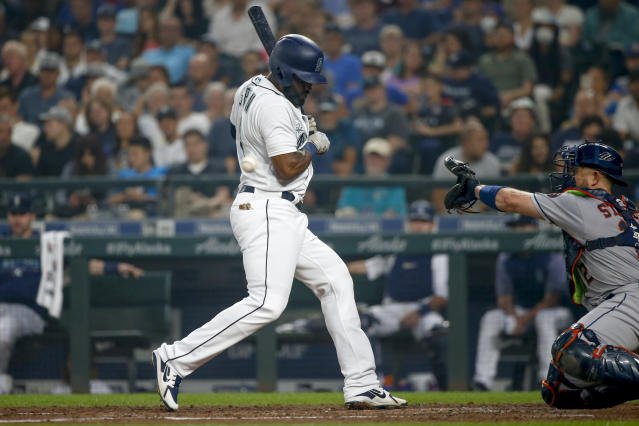 Seattle Mariners' Denard Span gets hit by a pitch from Houston Astros' Framber Valdez during the third inning of a baseball game Tuesday, Aug. 21, 2018, in Seattle. (AP Photo/Jennifer Buchanan)