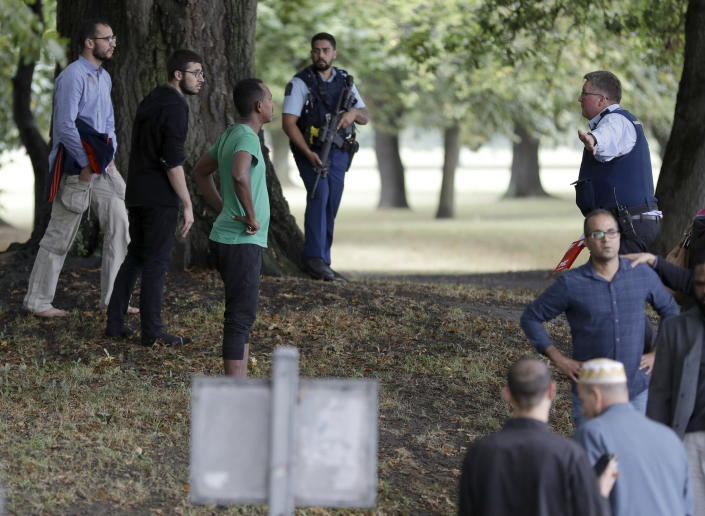 <p>Police attempt to move people away from outside a mosque in central Christchurch, New Zealand. Police have not yet described the scale of the shooting but urged people in central Christchurch to stay indoors. (AP Photo/Mark Baker) </p>