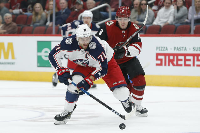 Columbus Blue Jackets left wing Nick Foligno (71) skates away from Arizona Coyotes center Clayton Keller in the first period during an NHL hockey game, Thursday, Nov. 7, 2019, in Glendale, Ariz. (AP Photo/Rick Scuteri)