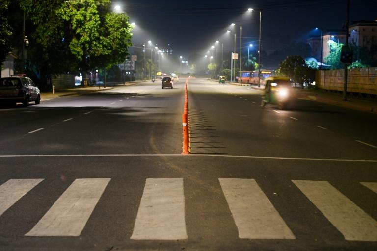 Streets were largely empty in New Delhi once the curfew went into effect, but some areas had regular night-time traffic