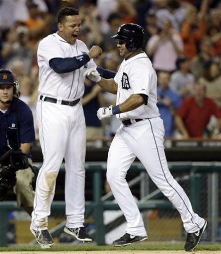Detroit Tigers shortstop Jhonny Peralta, right, celebrates with teammate Miguel Cabrera after hitting a two-run walkoff home run against Boston Red Sox relief pitcher Andrew Bailey in the ninth inning of a baseball game in Detroit, Thursday, June 20, 2013. Detroit won 4-3. (AP Photo/Paul Sancya)