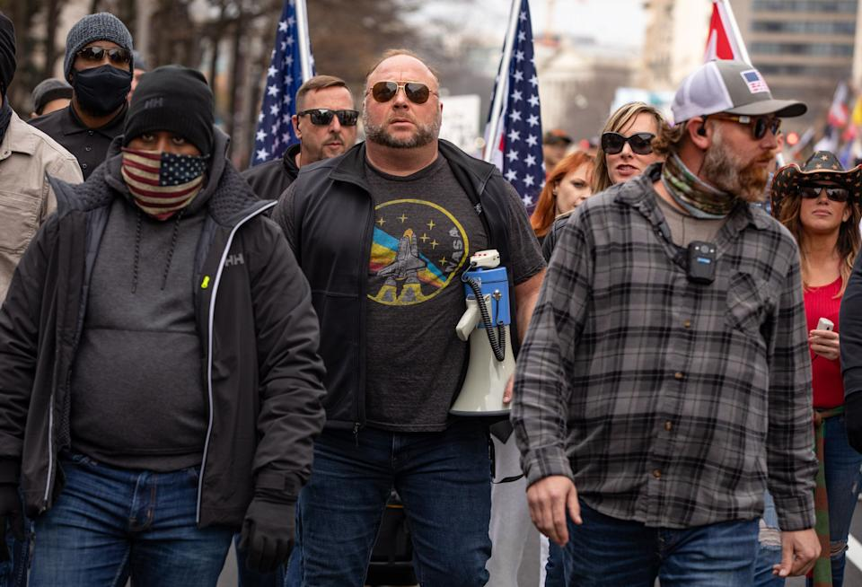 Far-right conspiracy theorist Alex Jones joins supporters of President Donald Trump at a rally in Washington Saturday. (Photo: The Washington Post via Getty Images)