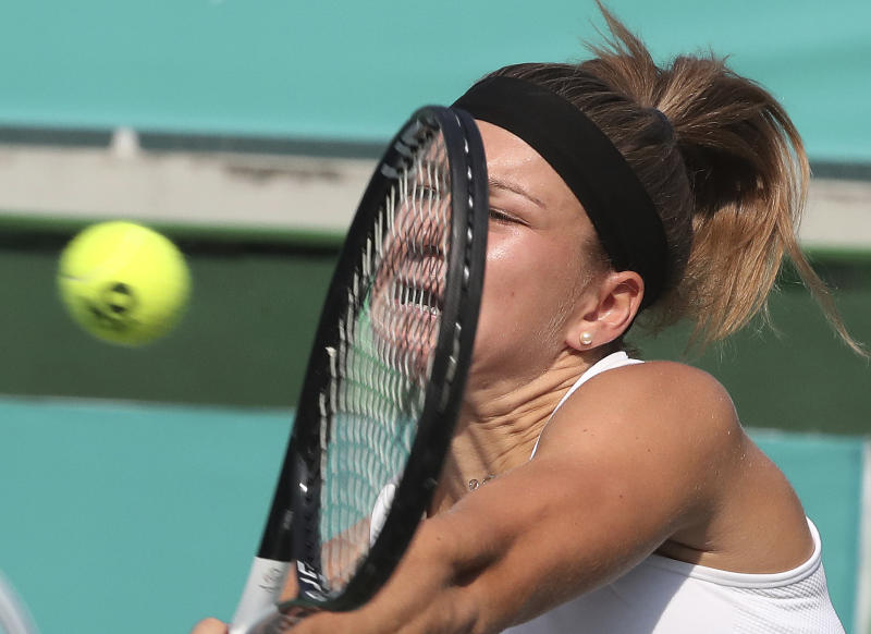 Karolina Muchova of the Czech Republic returns a shot to Timea Babos of Hungary during their second round match of the Korea Open tennis championships in Seoul, South Korea, Thursday, Sept. 19, 2019. (AP Photo/Ahn Young-joon)