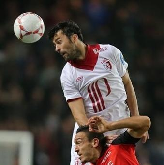 Lille's defender Marko Basa of Montenegro jumps for a header with Rennes' forward Mevlut Erding of Turkey during their french League One soccer match in Rennes, western France, Friday, Sept. 28, 2012. (AP Photo/David Vincent)