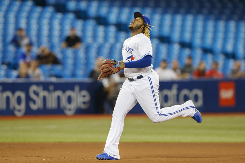 TORONTO, ON - SEPTEMBER 11: Vladimir Guerrero Jr. #27 of the Toronto Blue Jays runs to catch a pop fly during eighth inning of their MLB game against the Boston Red Sox at Rogers Centre on September 11, 2019 in Toronto, Canada. (Photo by Cole Burston/Getty Images)