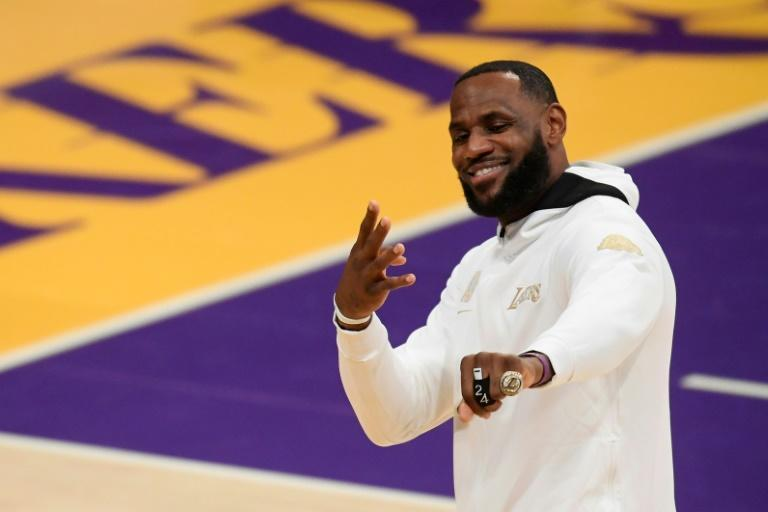 LeBron James shows off his 2020 NBA Championship ring, but the Los Angeles Lakers began their defense with a defeat to the Los Angeles Clippers
