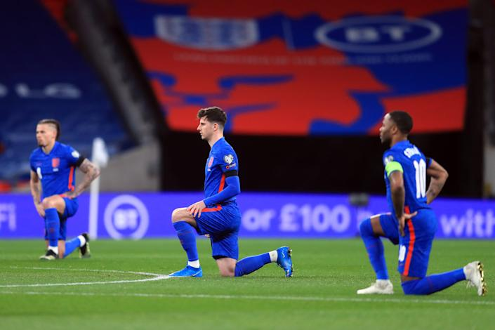England footballers take the knee in support of Black Lives Matter before last month's World Cup qualifier with San Marino at Wembley.