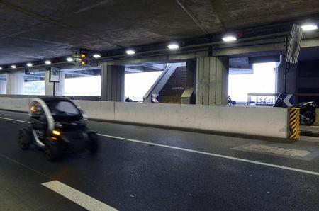 A vehicle drives through the Larvotto tunnel near the stairs (Rear) that access the Fairmont Hotel where the IAAF Council hosts a news conference after a meeting to discuss the latest developments in the doping and corruption crisis that has gripped the sport over recent months, in Monaco, November 26, 2015. REUTERS/Jean-Pierre Amet