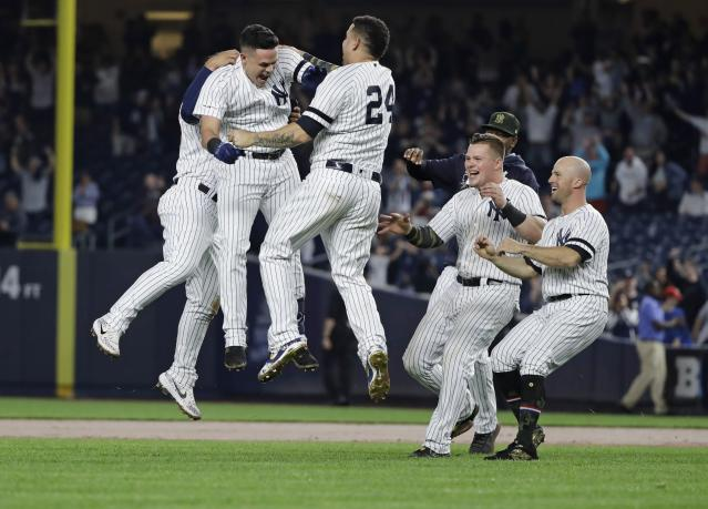 New York Yankees' Gio Urshela celebrates with teammates after hitting an RBI single during the ninth inning of the team's baseball game against the Tampa Bay Rays on Friday, May 17, 2019, in New York. The Yankees won 4-3. (AP Photo/Frank Franklin II)