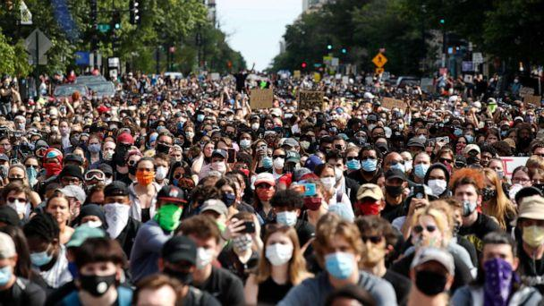 PHOTO: Demonstrators pause to kneel as they march to protest the death of George Floyd, Tuesday, June 2, 2020, in Washington. Floyd died after being restrained by Minneapolis police officers. (AP Photo/Alex Brandon) (Alex Brandon/AP Photo)