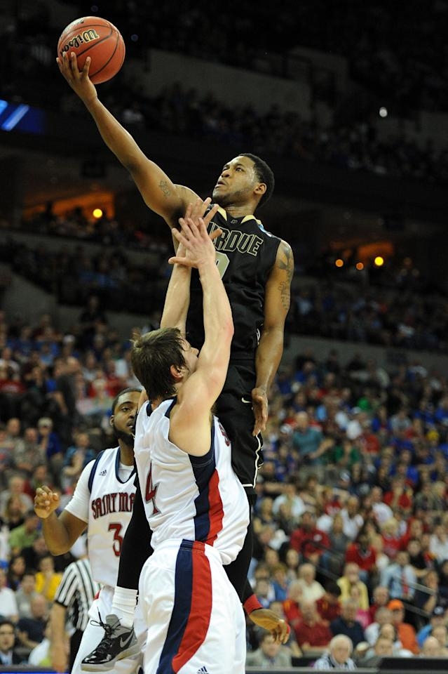 OMAHA, NE - MARCH 16:  Terone Johnson #0 of the Purdue Boilermakers attempts a shot against Matthew Dellavedova #4 of the St. Mary's Gaels during the second round of the 2012 NCAA Men's Basketball Tournament at CenturyLink Center on March 16, 2012 in Omaha, Nebraska.  (Photo by Eric Francis/Getty Images)