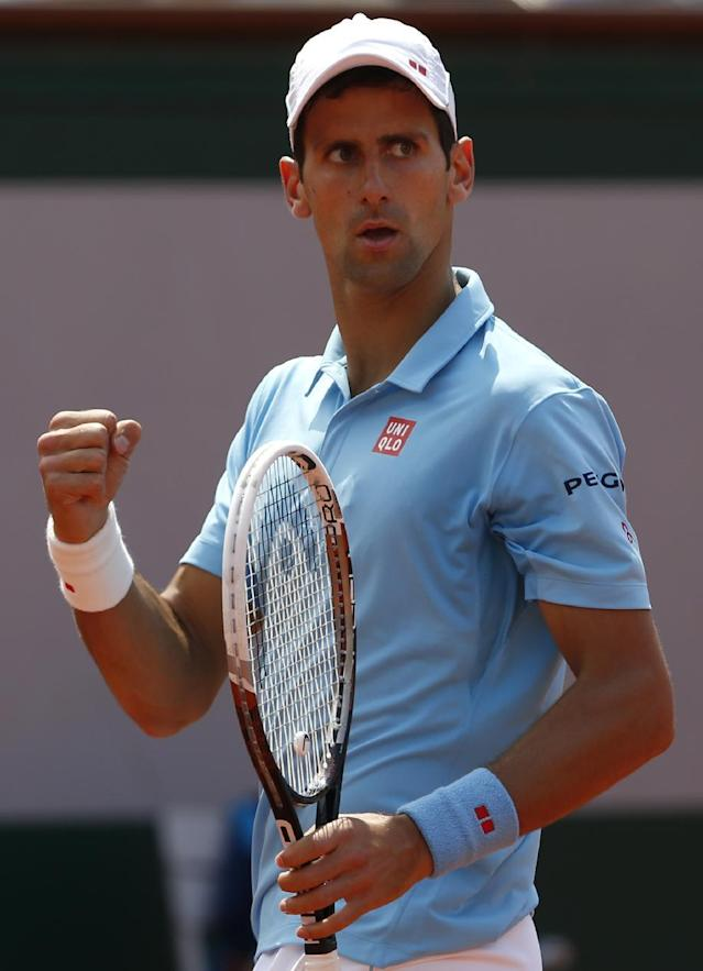 Serbia's Novak Djokovic reacts as he plays Spain's Rafael Nadal during the final match of the French Open tennis tournament at the Roland Garros stadium, in Paris, France, Sunday, June 8, 2014. (AP Photo/Darko Vojinovic)