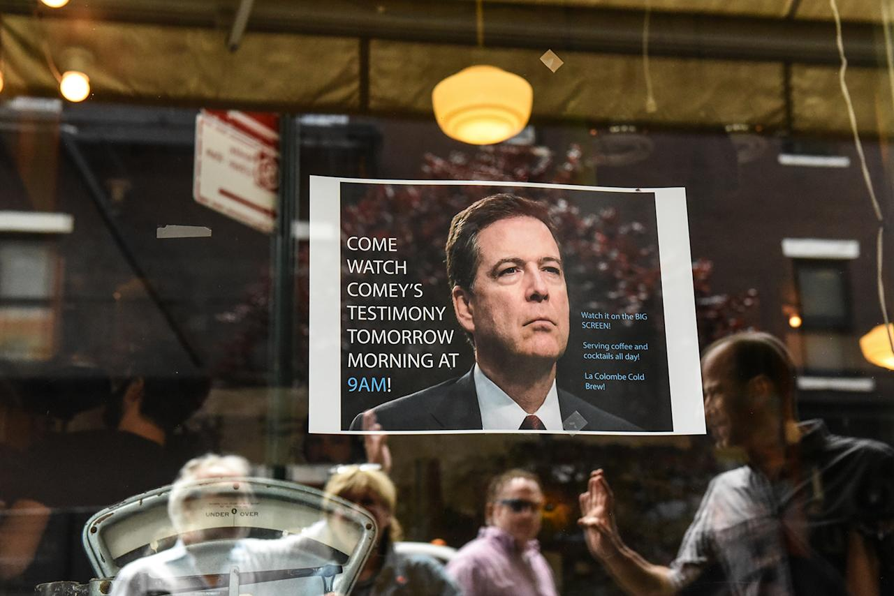 <p>A sign advertising a watch party to see testimony from former FBI Director James Comey during a Senate Intelligence Committee hearing on Russian interference in the 2016 U.S. election on June 8, 2017 at a restaurant (Stephanie Keith/Getty Images) </p>
